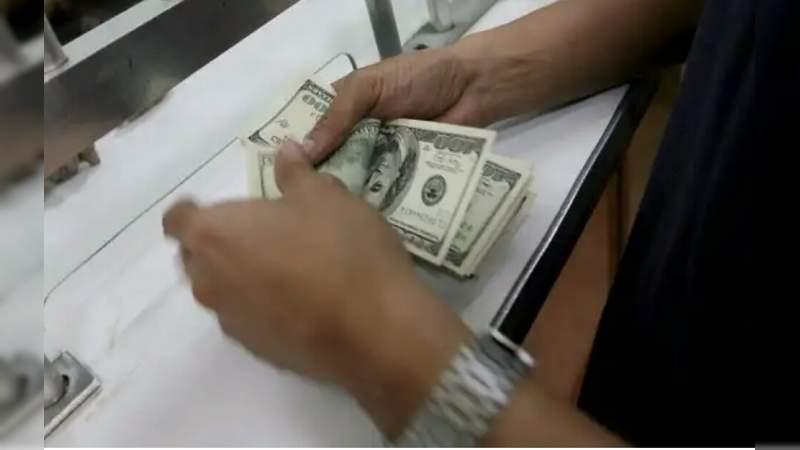Tras informe de AMLO, dólar alcanza un nuevo máximo histórico