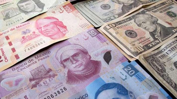 Hasta en 19.60 pesos cierra dólar en bancos