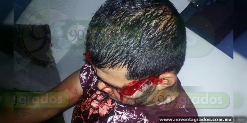 Atacan a machetazos a empleado de hotel durante asalto en Apatzingán, Michoacán 0-grande