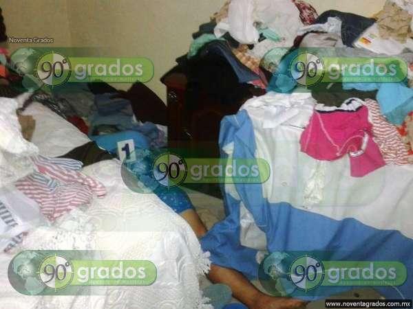 Hallan a mujer asesinada en su propio cuarto, en Huetamo, Michoacán
