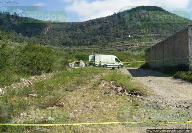 Hallan cadáver de joven lapidado a las afueras de Morelia