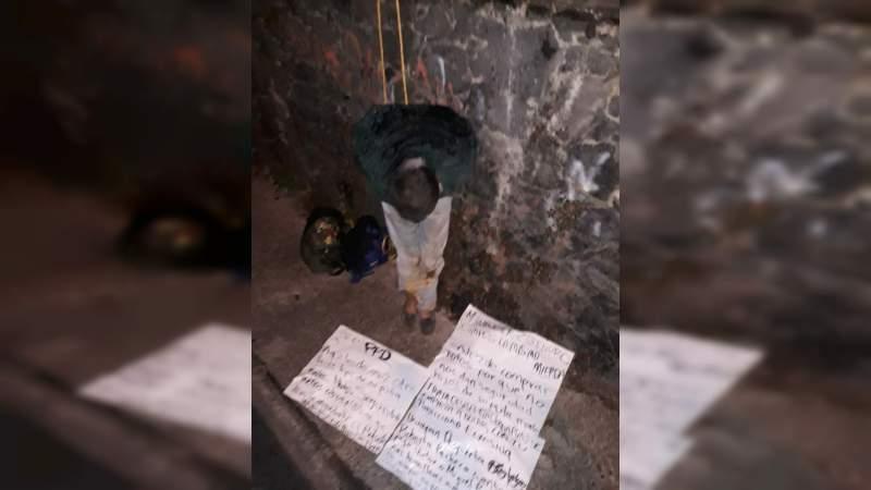 Exhiben a presunto delincuente y le dejan consignas contra Víctor Manuel Manríquez González
